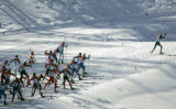 Zsolt Antal, of Romania, leads the pack as they climb a hill in the men's 50KM Cross Country Mass...