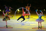 A performer rides a metal ring around the stage during the Closing Ceremony for the 2006 Winter...
