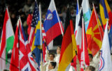 Flagbearers hold the flags of all the nations participating in the 2006 Winter Olympics at the...