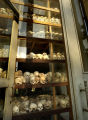 Phnom Penh, Cambodia.  November 2, 2003.   A tower of victims' skulls is displayed at the Choeung...