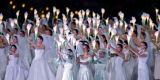 "Brides, 398 of them to be exact, hold up flowers that act as lamps in the ""River of..."