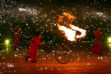 A flaming bull is pushed around stage by a performer duirng the Closing Ceremony for the 2006...