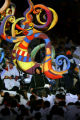 A performer carries a work of art atop his shoulders during the Closing Ceremony for the 2006...