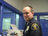 Hand in photo of Larimer County Sheriff's Deputy Travis Sass who ws killed in a car crash on U.S....