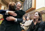 Steve Farber (cq) is hugged by State Rep Fran Coleman (D-  HD- 1) after Farber and the American...