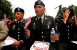 Denver, Colo., photo taken July 4, 2004- (left to right) private 1st class Mihran Saghbazarian...