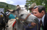 07/04/2004 Aspen, Colorado - Sloan Shoemaker, Basalt, wearing a George W. Bush mask, kisses Tom...