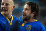 Sweden's Peter Forsberg (right) celebrates with teammate Mats Sundin (left) after winning the gold...