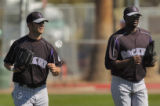 Rockies outfielders Cory Sullivan, left, and Choo Freeman head in from the outfield after practice...