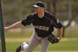 Colorado Rockies picture Aaron Cook throws the ball during batting  practice Sunday February 26,...