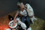 On March 14, 2006, Haystack Mountain Goat Dairy cheese maker Heidi Olson (cq) gets a kiss from one...