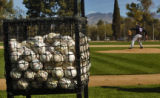 Rockies picture Ramon Ramirez throws to home during practice Tuesday morning February 28, 2006 at...