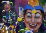 STAFF PHOTO BY BRETT DUKE The Rex parade makes its way St. Charles Ave. near Canal Street Tuesday,...