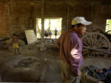 Battambang, Cambodia.  November 9, 2003.  Setan Lee walks through an empty building where he says...