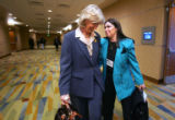 Outgoing Secretary of the Interior Gale Norton, left, talks with Sally Wisely, right, state...