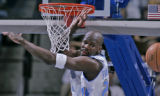 Denver Nugget guard Ruben Patterson misses a dunk  in the third quarter of play Wednesday March 1,...