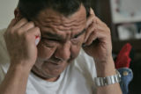 Paul Mendez (cq) talks to a friend on his cell phone about the death of his 18-month-old daughter...