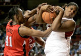 Courtney Paris of OU fights with LaToya Davis of Texas Tech during the first half of the...