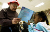 (DENVER, Colo., Feb. 2, 2006) Para-professional, Stan Boxer, cq, at Lowry Elementary School, looks...