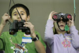 Saul Briney (cq) 9,  and Breanna Tobias (cq), 8 , third-grade students from Monoco Elementary use...