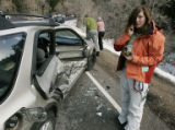 (DENVER, Colo., June 16, 2004) Firefighters look over a car wreck that resulted in fatalities at...