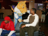 Denver Nuggets player DerMarr Johnson, left, Rocky the mascot and player Marcus Camby are ready to...