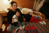 Joelene Mix (cq) sits in a hotel room in Glendale on March 17, 2006, with her two sons, Carlos...
