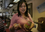 At Tony's Meat, Regina Ferand (cq) opens her treasure -- a jar of Creole Mustard.  She has been...