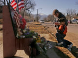 Isaak Gomez (cq),5, of Colorado Springs kneels to pray with his grandmother Ruby Hamman (cq) at a...