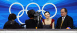 U.S. figure skater Sasha Cohen flashes a smile as her scores are announced during the Women's Free...