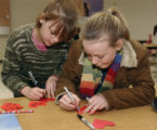 L to R: Alex Gaiswiakler(cq) ,age 10, and Cortney Jessres(cq),  age 10, sign hearts during a...