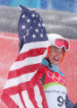 Julia Mancuso, of the USA,waves the U.S. flag as she celebrates after winning the gold medal in...