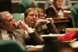 Rep. Mike May, R-Parker, center, listens to debates on amendments to his anti-smoking bill on...