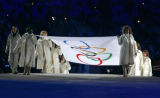 The Olympic Flag makes its way into the Stadio Olimpico carried by eight women during the Opening...
