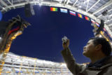 Filippi Marco (cq) of Torino, Italy uses a camera to record a few snapshots of the Stadio Olimpico...