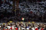 An athlete raises a lone Italian flag at the Opening Ceremonies for the 2006 Winter Olympics which...