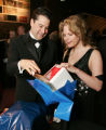 (Denver, Colo., March 4, 2006) Auction chairs Aaron and Sandee Lapedis open a mystery gift in...