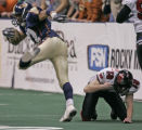 Colorado Crush Willis Marshal, left, escapes a tackle from Grand Rapids Rampage kicker Peter...