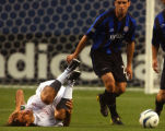 Denver, Colo., photo taken July 4, 2004- New England's Jose Cancela (7 left IN white) takes a fall...
