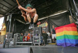 Eric Melvin, guitarist for the band NOFX leaps on the Teddy Bear Stage during the Vans Warped Tour...