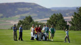 Junior golfer Bobby Moyer (far right), 12, of Aspen reacts after dropping an approach shot close...