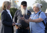 L to R: Peggy Lamm (cq) greets voters Butch Gray (cq) and Mary Gray (cq)  at the Commerce City...