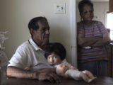 Yariah Santistevan,2, sister of Deion Santistevan, sits with her great -grandparents Rudy and Lucy...