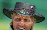 Australian golfer Greg Norman flashes a smile to the gallery in his trademark hat on the 18th...