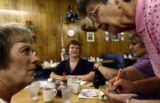 Copper Kitchen waitress, Norma Cox(cq), right, takes Sherry Davidson's(cq) breakfast order in La...