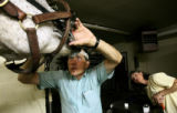 "Veterinarian Zane Leininger(cq) checks out the teeth of ""Ole Dan Missile"" as owner..."