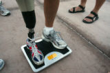Dan Jensen, of South Dakota, who has an artificial leg, is weighed-in before starting Kiehl's...