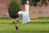 (DENVER, Colo., July 5, 2004) Helen Childes places a vase of flowers on the grave of her son Pauls...