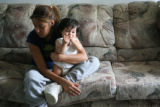 Johana Rodriguez, cq, (16) holds her niece Julie Ramirez, (9 months) Thursday Aug. 10, 2006 as she...