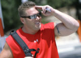 Denver Broncos kicker Todd Sauerbrun salutes the media as he arrives for training camp to answer...